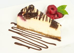 Baked Raspberry Brownie Cheesecake Plated